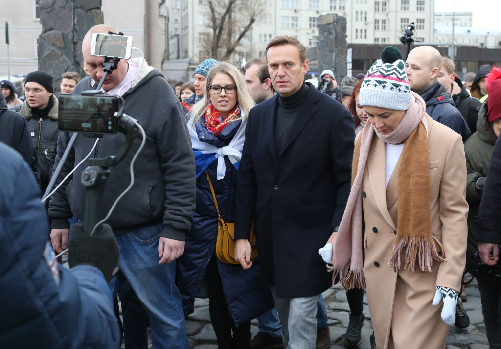 Russian opposition leader Alexei Navalny and responsive from the coma, hospital says