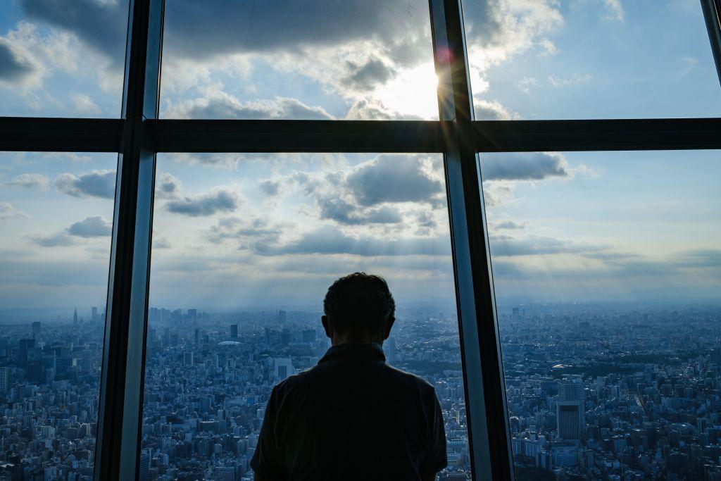 Japan economy shrinks pandemic shot at record rate