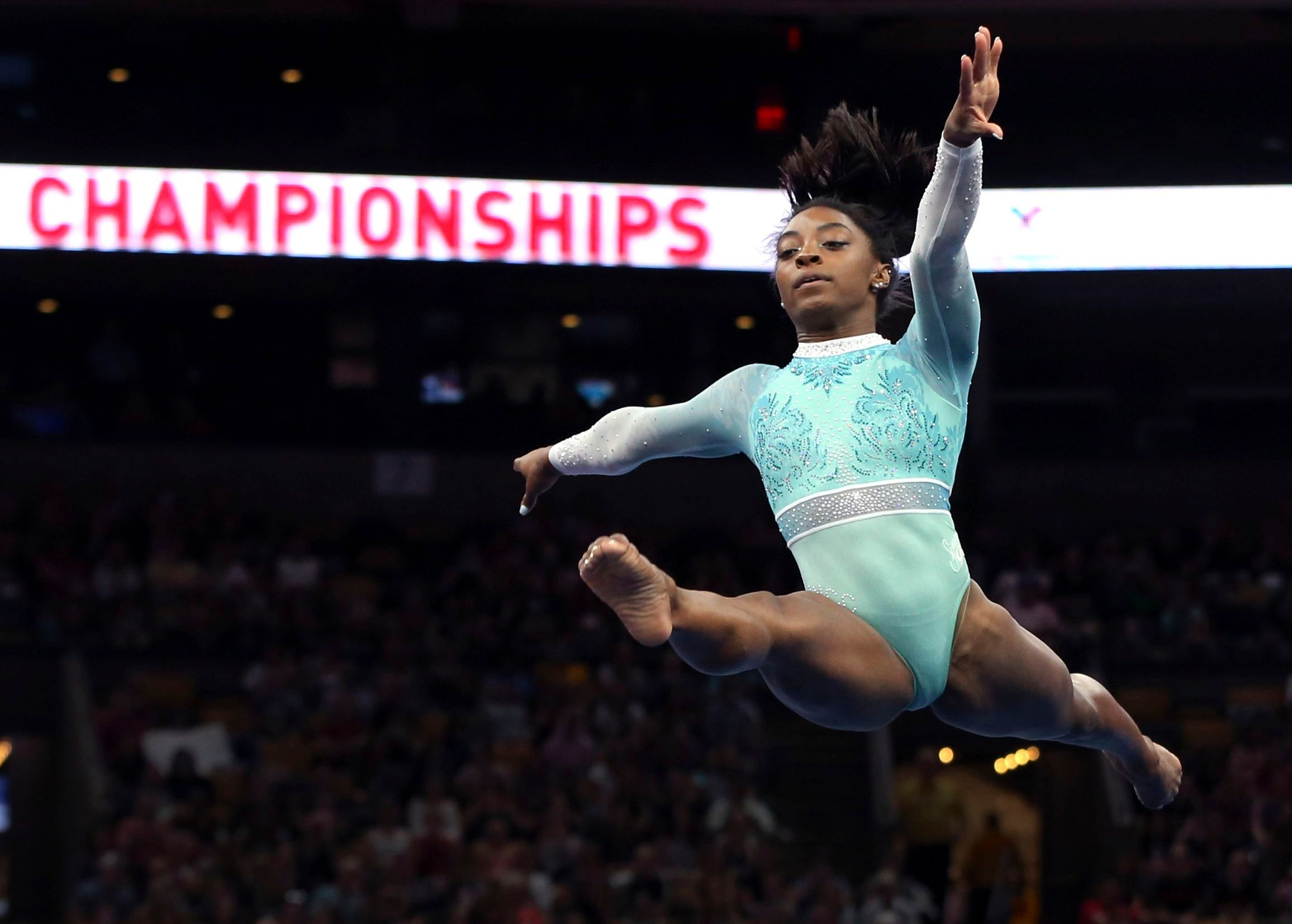 I'm with them. 'Simone Biles Porta Teal Body in solidarity with the gymnasts abused by Larry Nassar