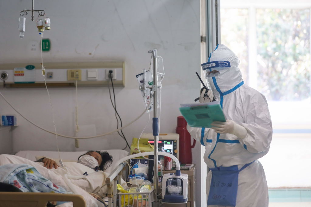 Hospitals in China, overwhelmed by the coronavirus, turn away patients with other pressing needs